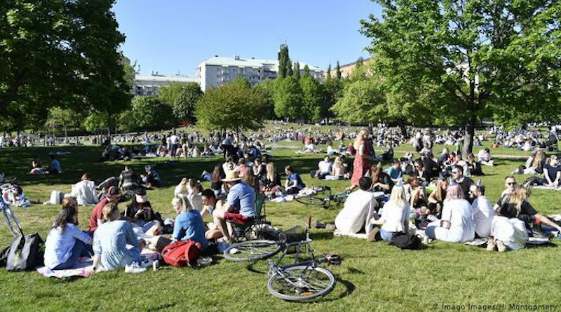 People in a park in Stockholm without observing social distancing. Images / H. Credit: Imago Images/H. Montgomery. Source: The Coversation.