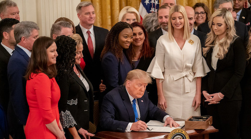 President Trump signs an Executive Order at the White House Summit on Human Trafficking in honour of the 20th Anniversary of the Trafficking Victims Protection Act of 2000, Jan. 31, 2020. Official White House Photo by Andrea Hanks.
