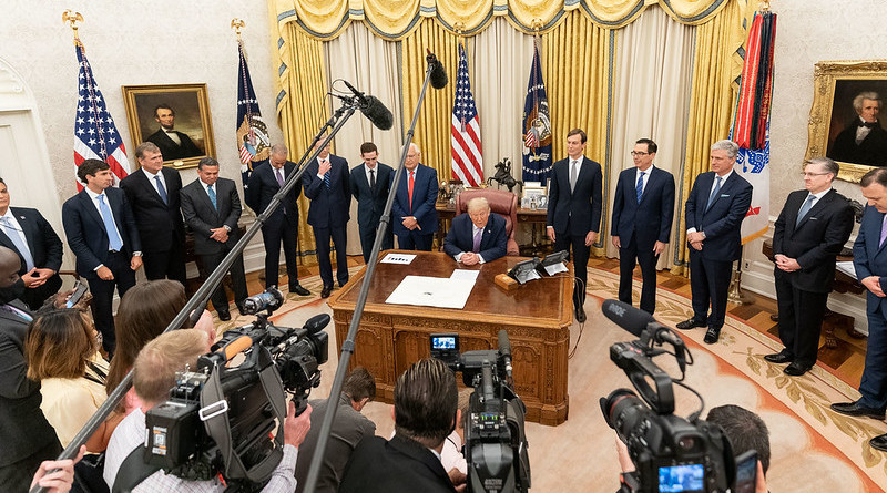 President Donald J. Trump, joined by White House senior staff members, delivers a statement announcing the agreement of full normalization of relations between Israel and the United Arab Emirates Thursday, Aug. 13, 2020, in the Oval Office of the White House. (Official White House Photo by Joyce N. Boghosian)
