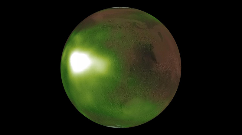 """This is an image of the ultraviolet """"nightglow"""" in the Martian atmosphere. Green and white false colors represent the intensity of ultraviolet light, with white being the brightest. The nightglow was measured at about 70 kilometers (approximately 40 miles) altitude by the Imaging UltraViolet Spectrograph instrument on NASA's MAVEN spacecraft. A simulated view of the Mars globe is added digitally for context. The image shows an intense brightening in Mars' nightside atmosphere. The brightenings occur regularly after sunset on Martian evenings during fall and winter seasons, and fade by midnight. The brightening is caused by increased downwards winds which enhance the chemical reaction creating nitric oxide which causes the glow. Credits: NASA/MAVEN/Goddard Space Flight Center/CU/LASP"""
