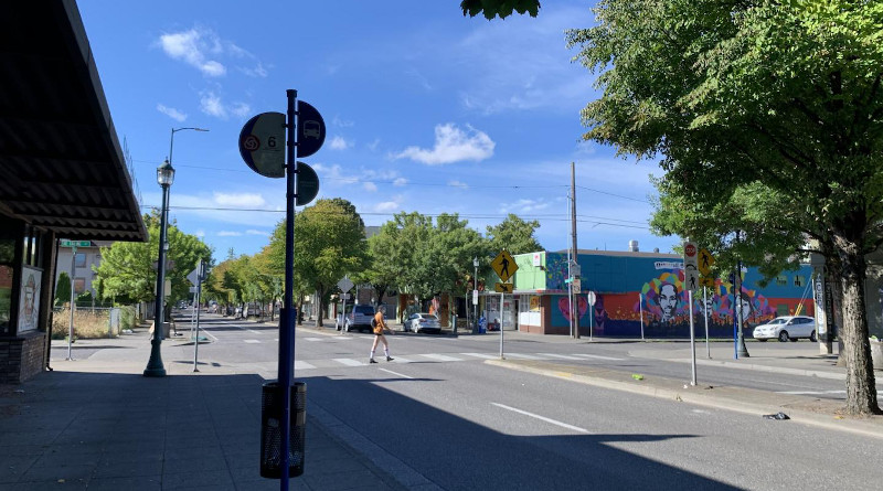 View of North MLK Boulevard in Portland, Oregon with a pedestrian crossing near a mural. CREDIT: Photo by Cait McCusker
