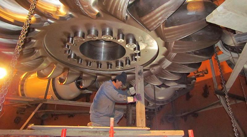 A worker installs a turbine at the Moynak hydropower plant in Kazakhstan's east. (Moynak GES handout)