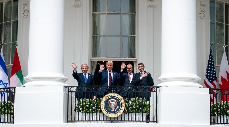 President Donald J. Trump, Minister of Foreign Affairs of Bahrain Dr. Abdullatif bin Rashid Al-Zayani, Israeli Prime Minister Benjamin Netanyahu and Minister of Foreign Affairs for the United Arab Emirates Abdullah bin Zayed Al Nahyanisigns wave from the Blue Room balcony during the Abraham Accords signing Tuesday, Sept. 15, 2020, at the White House. (Official White House Photo by Tia Dufour)