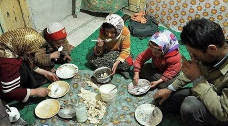 Poor family in Iran eating a meal. Photo Credit: Iran News Wire
