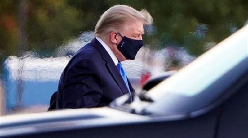 US President Donald Trump wears a mask. Photo Credit: Tasnim News Agency