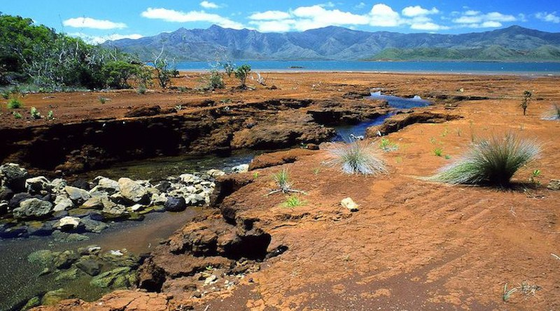 A creek in southern New Caledonia. Red colours reveal the richness of the ground in iron oxides and nickel.) CC BY 2.5