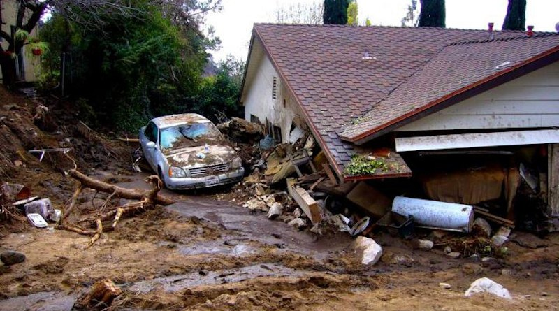 House damaged by debris flows generated in Los Angeles County's Mullally Canyon in response to a rainstorm on February 6, 2010. CREDIT: Susan Cannon/USGS