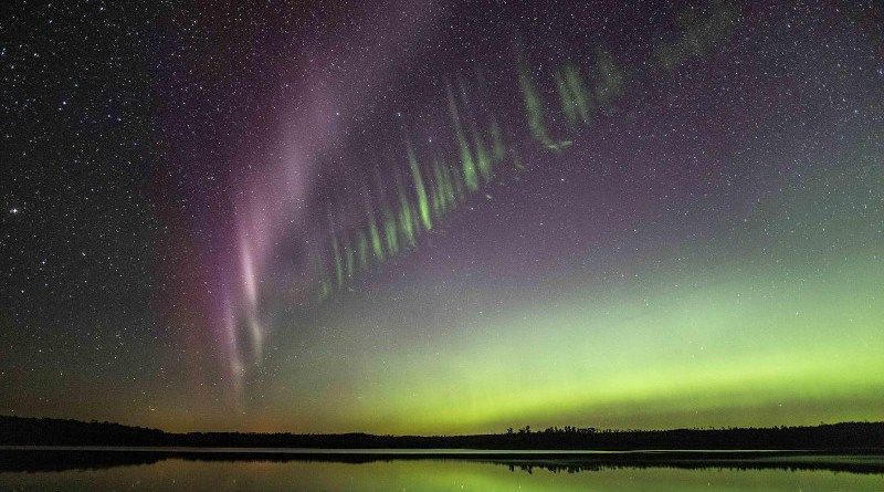 "Taken July 17, 2018, at Little Kenosee Lake, Saskatchewan, Canada, this photo shows the tiny green streaks below STEVE. Neil Zeller, photographer and co-author on the paper, commented ""STEVE was bright and powerful for a full hour that night."" CREDIT: Copyright Neil Zeller, used with permission"
