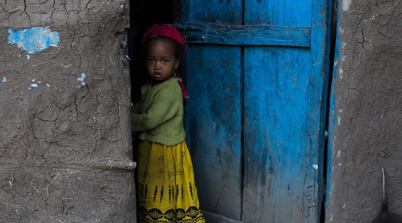 A girl stands outside her home in the Tigray Region, Ethiopia. Credit: UNICEF/Tanya Bindra