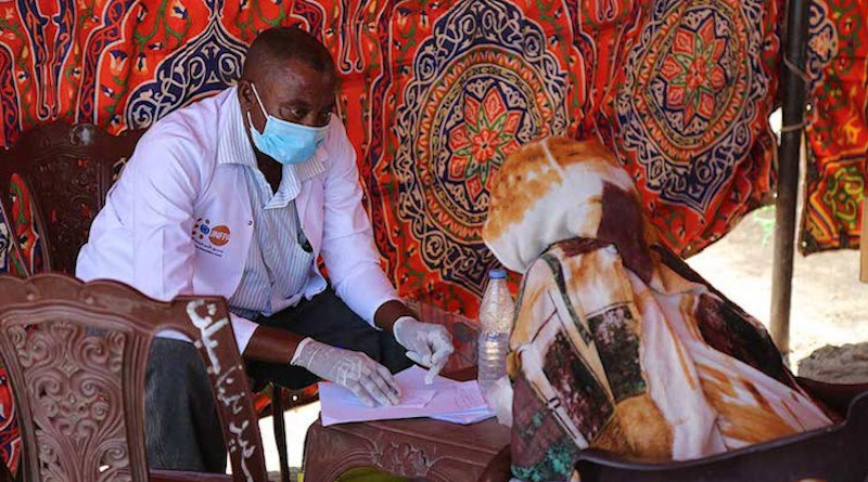 A woman receives health services at a transit point in Hamdayet. Credit: UNFPA Sudan/Sufian Abdul-Mouty.