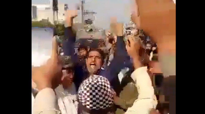"""Pakistani security guard Ahmad Nawaz killed a bank manager accusing him of blasphemy. The crowd greets him with slogans, such as """"Behead those who insult the Prophet"""". Photo Credit: Twitter."""