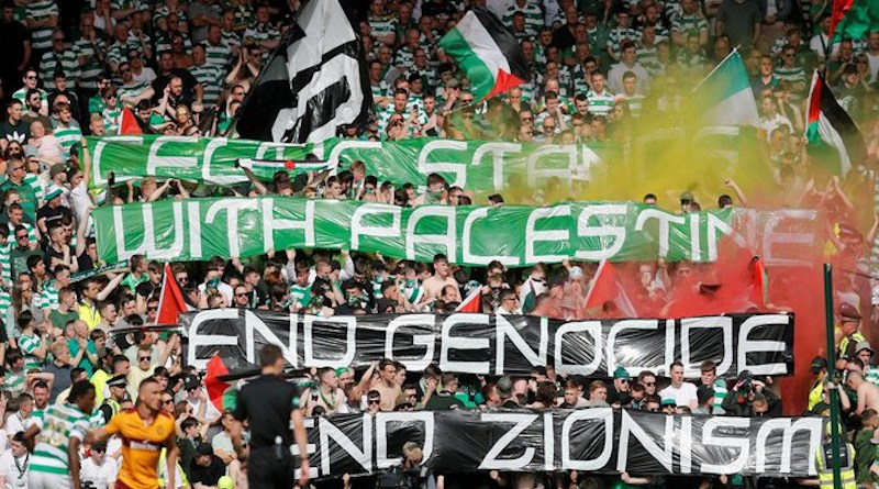 Supporters of Scotland's Celtic FC fly Palestine flags. Photo Credit: AJ+, Palestine Chronicle