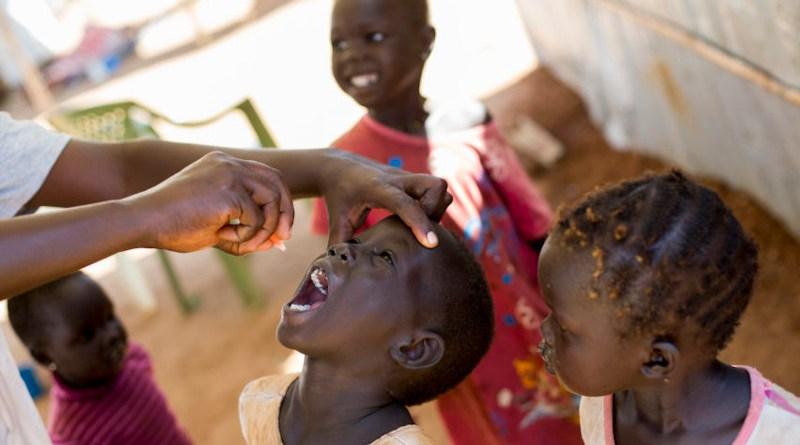A child receiving polio vaccine. Copyright: UN Photo/JC McIlwaine, CC BY-NC-ND 2.0