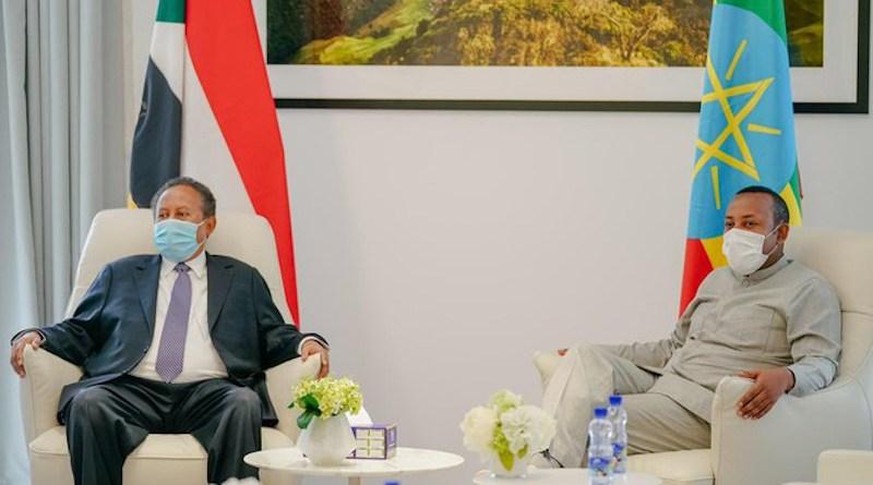 Sudan's Prime Minister Abdalla Hamdok in Ethiopia with Prime Minister Abiy Ahmed Ali. (Twitter/@SudanPMHamdok)