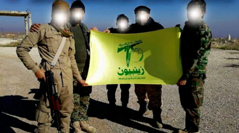Undated photo of Pakistani members of Zainebiyoun Brigade holding their flag in Syria. Photo Credit: Social media