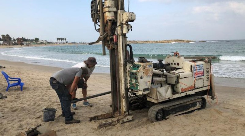 Geoprobe drilling rig extraction of a sediment core with evidence of a tsunami from South Bay, Tel Dor, Israel CREDIT Photo by T. E. Levy