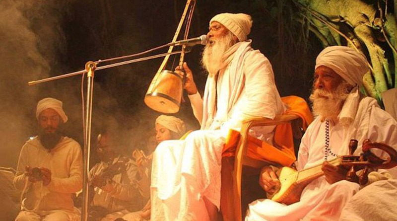 A Baul sings as he plays a traditional single-string musical instrument called 'Ektara,' at a rural concert in Munshiganj district, Bangladesh. Dec. 26, 2019. [BenarNews]
