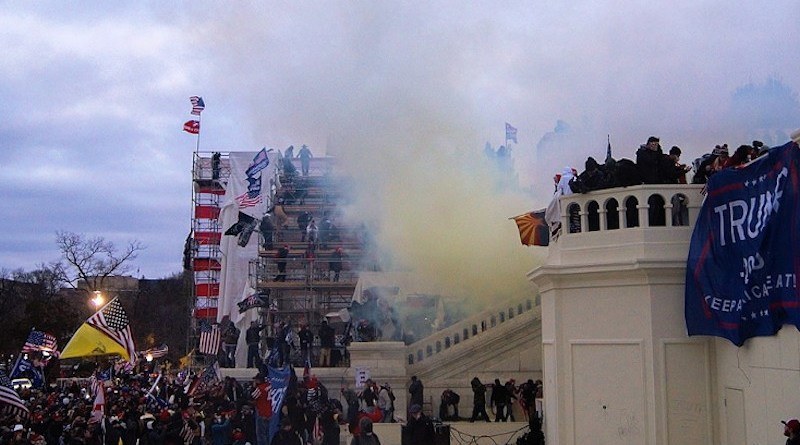 Tear gas outside the United States Capitol on January 6, 2021 as mob storms the building. Photo Credit: Tyler Merbler, Wikimedia Commons