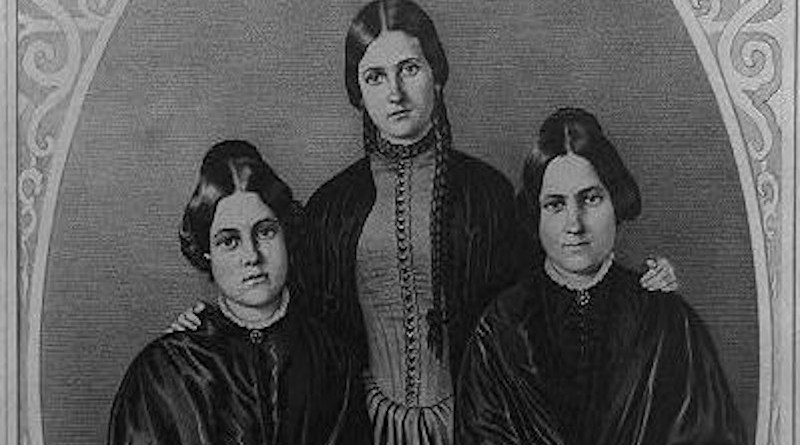 The Fox sisters: Kate (1838-92), Leah (1814-90) and Margaret (or Maggie) (1836-93). Lithograph after a daguerreotype by Appleby. Published by N. Currier, New York. In 1848, two sisters from upstate New York, Maggie and Kate Fox, reported hearing 'rappings' and 'knocks' that they interpreted as communication coming from a spirit in their house. These events and these sisters would eventually be considered the originators of Spiritualism. CREDIT N. Currier, New York