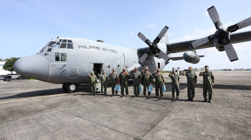 Members of the Philippine Air Force receive a C-130H plane acquired from the U.S. government, Jan. 29, 2021. Handout Philippine Air Force