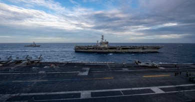 The Theodore Roosevelt Carrier Strike Group transits in formation with the Nimitz Carrier Strike Group in the South China Sea Feb. 9, 2021. Photo Credit: Seaman Deirdre Marsac