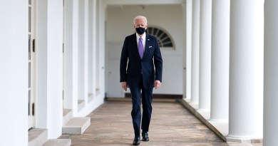 President Joe Biden walks along the Colonnade to the Oval Office of the White House. (Official White House Photo by Adam Schultz)