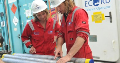 Sean Gulick, a research professor at The University of Texas at Austin Jackson School of Geosciences (right), and Joanna Morgan, a professor at Imperial College London, examining cores retrieved from the crater during the 2016 research mission led by the International Ocean Discovery Program. CREDIT The University of Texas at Austin/ Jackson School of Geosciences