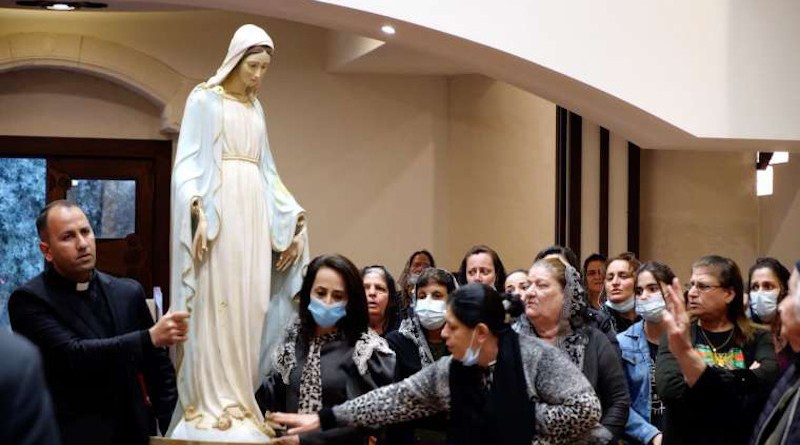 A Marian statue is returned to St. Adday church in Karemlesh, Iraq, March 19, 2021. Photo courtesy Fr. Thabet Habeb.
