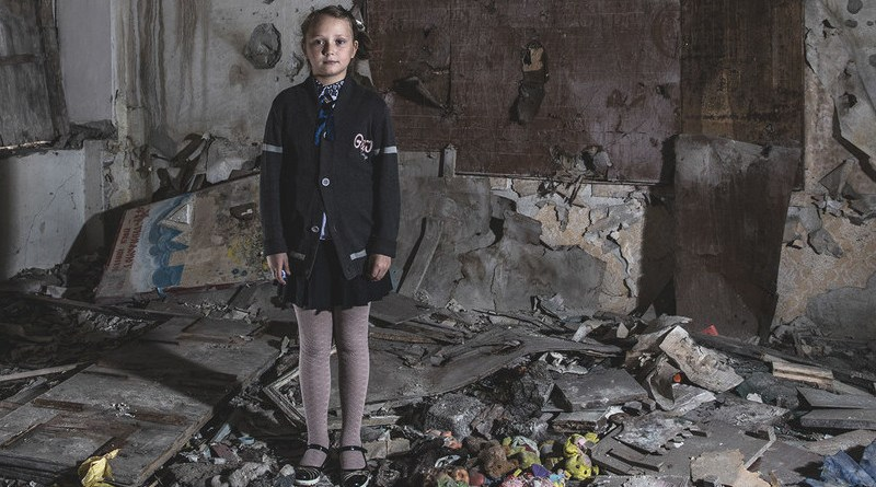Masha Khromchenko stands in the kindergarten classroom that took a direct hit from a shell in the Luhansk region, Ukraine. Credit: UNICEF/Christopher Morris