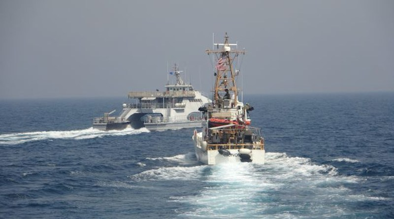 Iran's Islamic Revolutionary Guard Corps Navy (IRGCN) Harth 55, left, conducted an unsafe and unprofessional action by crossing the bow of the Coast Guard patrol boat USCGC Monomoy (WPB 1326), right, as the U.S. vessel was conducting a routine maritime security patrol in international waters of the southern Arabian Gulf, April 2, 2021. Photo Credit: US Navy