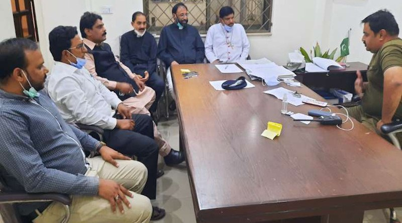 Bishop Indrias Rehmat (right) with a Catholic delegation at Civil Lines Police Station in Faisalabad on April 9. (Photo supplied)