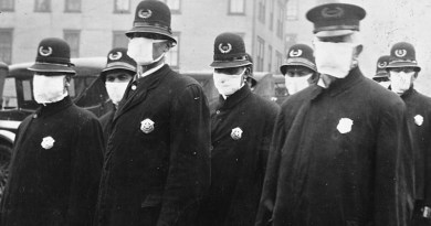 Policemen in Seattle wearing masks made by the Red Cross, during the influenza epidemic. December 1918. Photo Credit: Author unknown, Wikimedia Commons