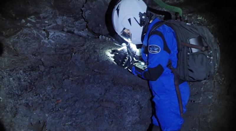 HI-SEAS crewmember exploring Mauna Loa's lava tubes as analogs for lava tubes on Mars and the moon. CREDIT HI-SEAS