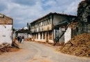 Streetscape of destroyed village during Kosovo War, 1999. Photo Credit: Marietta Amarcord, Wikipedia Commons