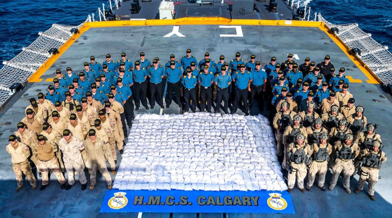 Members of HMCS CALGARY stand with 1286kg of heroin seized from a dhow during a counter-smuggling operation on 23 April, 2021 in the Arabian Sea during OPERATION ARTEMIS and as part of Combined Task Force 150. Please credit: Corporal Lynette Ai Dang, Her Majesty's Canadian Ship CALGARY, Imagery Technician ©2021 DND/MDN CANADA
