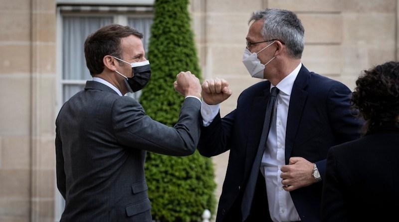 Secretary General Jens Stoltenberg with French President Emmanuel Macron. Photo Credit: NATO