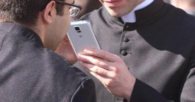 priest catholic smartphone