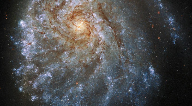 This spectacular image from the NASA/ESA Hubble Space Telescope shows the trailing arms of NGC 2276, a spiral galaxy 120 million light-years away in the constellation of Cepheus. At first glance, the delicate tracery of bright spiral arms and dark dust lanes resembles countless other spiral galaxies. A closer look reveals a strangely lopsided galaxy shaped by gravitational interaction and intense star formation. CREDIT ESA/Hubble & NASA, P. Sell Acknowledgement: L. Shatz