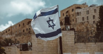 Israeli flag in Jerusalem. Photo: Taylor Brandon (@house_42), Unsplash