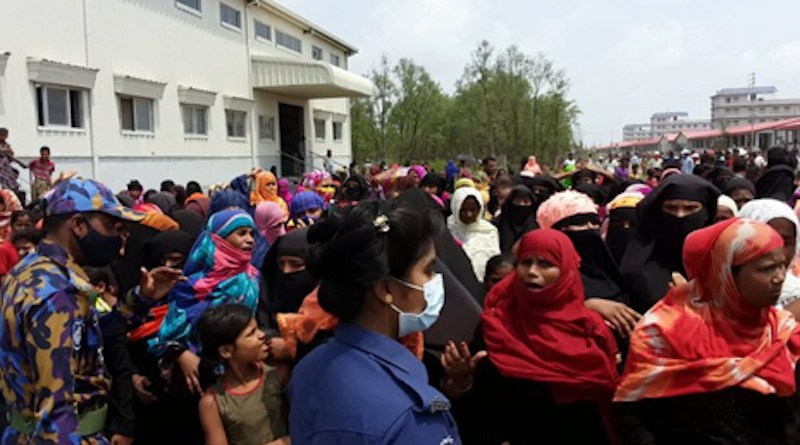 Rohingya refugees gather in an area of a complex housing at Bhashan Char in Bangladesh during a visit by senior officials of the United Nations refugee agency (UNHCR), May 31, 2021. (Source: BenarNews)