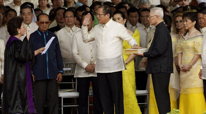 Benigno Aquino III takes the oath of office as the 15th President of the Philippines before Associate Justice Conchita Carpio-Morales at the Quirino Grandstand on June 30, 2010. Photo Credit: Rey S. Baniquet - Office of the Press Secretary, Wikipedia Commons