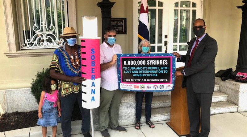Rodney González, Chargé d'affaires at the Cuban Embassy, welcomes the donation of six million syringes. Photo Credit: COHA
