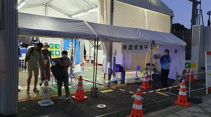 Temperature check and COVID-19 countermeasures at the Japan Olympics tennis venue. Photo Credit: Syced, Wikipedia Commons