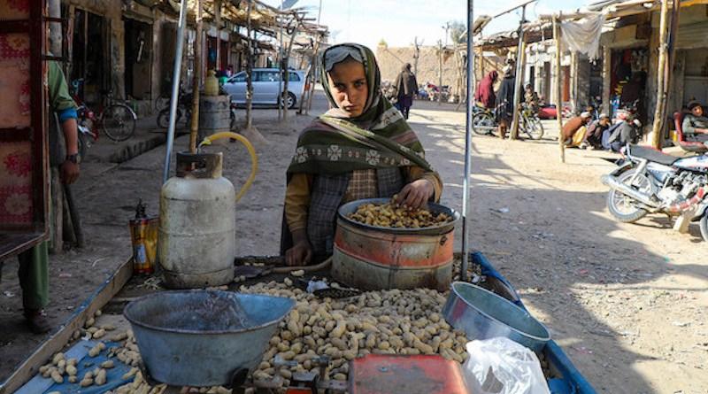 A young market vendor sells peanuts in Urozgan, a central province of Afghanistan. © UNICEF/Omid Fazel