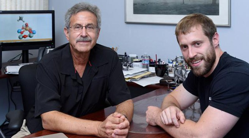 Benjamin Snyder (right) and his former PhD adviser, Edward Solomon, a professor of chemistry at Stanford and of photon science at SLAC. CREDIT Linda A. Cicero