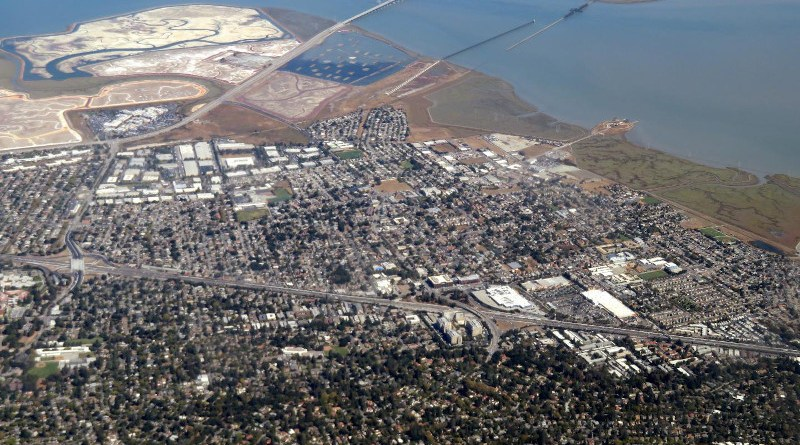 An aerial view of East Palo Alto, which borders San Francisco Bay. New research shows about half the households in East Palo Alto are at risk of financial instability from existing social factors or anticipated flooding through 2060. (Image credit: Wikimedia Commons)