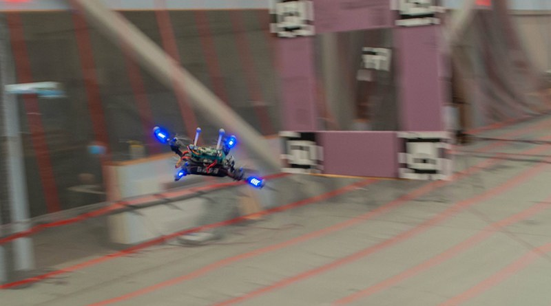 A quadcopter flies a racing course through several gates in order to find the fastest feasible trajectory. CREDIT: Courtesy of Sertac Karaman, Ezra Tal, et al