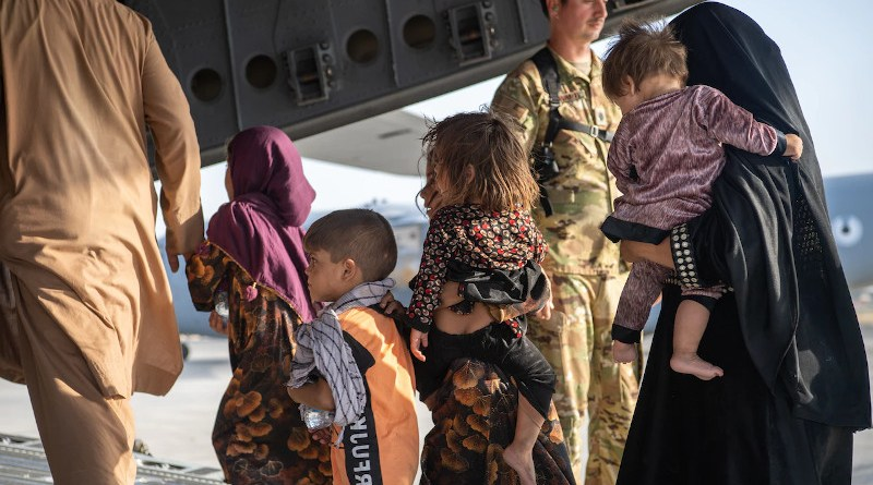 Air Force loadmasters and pilots assigned to the 816th Expeditionary Airlift Squadron help passengers board a U.S. Air Force C-17 Globemaster III in support of the Afghanistan evacuation at Hamid Karzai International Airport in Kabul, Afghanistan, Aug. 24, 2021. Photo Credit: DOD