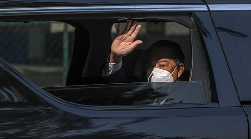 Prime Minister Muhyiddin Yassin waves as he leaves the Palace after meeting with King Al-Sultan Abdullah Ri'ayatuddin Al-Mustafa Billah, in Kuala Lumpur, Aug. 4, 2021. Photo Credit: S. Mahfuz/BenarNews