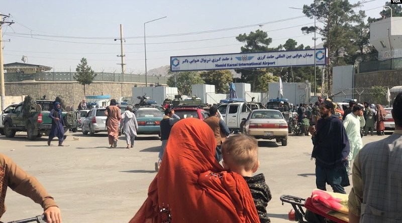 On the second day of the Taliban's rule in Kabul, the front of Hamid Karzai International Airport was crowded with people trying to travel abroad, but were stopped by Taliban militants. Photo Credit: VOA, Wikipedia Commons